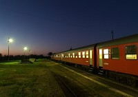 An MDmot DMU at sunset at Nagykereki station