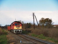 The M62 165 between Sz�kesfeh�rv�r and Sz�razr�t with a freight train