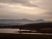 The view of the Mátra mountain range and a reservoir by Vizslás