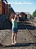 A girl taking photos of the locomotives at the Hatvan depot