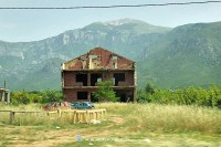 A ruined and gunhit house near Mostar