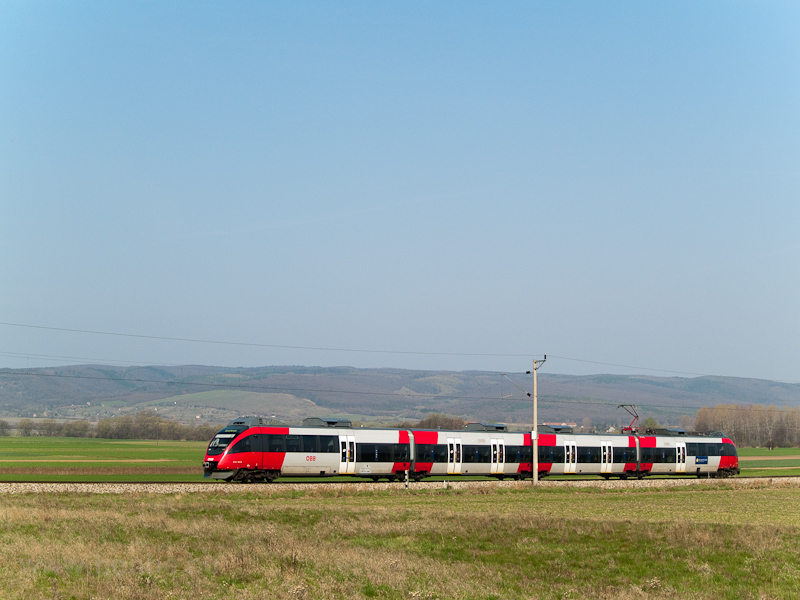 An ÖBB Talent seen between Harka and Sopronkeresztúr (Deutschkreutz, Austria) on the line that is only accessible through Hungary and is completely electrified by the Hungarian 25 kV 50 Hz catenary photo