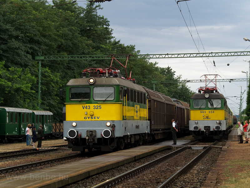 The GYSEV V43 325 is seen hauling a freight train and the V43 334 returning to Sopron at the end of a slow train at Fertőboz station photo