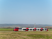 An ÖBB Talent seen between Harka and Sopronkeresztúr (Deutschkreutz, Austria) on the line that is only accessible through Hungary and is completely electrified by the Hungarian 25 kV 50 Hz catenary
