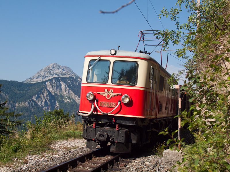 The BBÖ 1099.02 historic electric locomotive seen between Gösing and Annaberg with the Ötscher's peak in the background photo