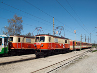 The NÖVOG 1099.001 is seen arriving in Klangen with a completely Jaffa-coloured train