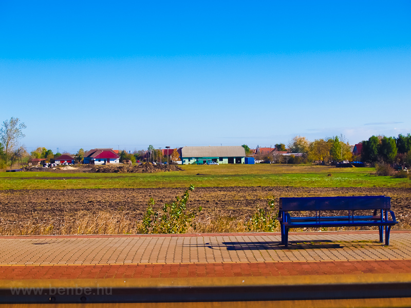 Bench and landscape at Tiszatenyő station photo