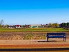 Bench and landscape at Tiszatenyő station