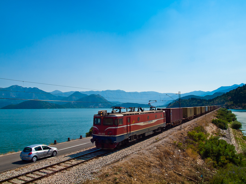 The MonteCargo 461-042 seen between Virpazar and Vranjina hauling a container train from the harbour of Bar across Lake Skadar photo