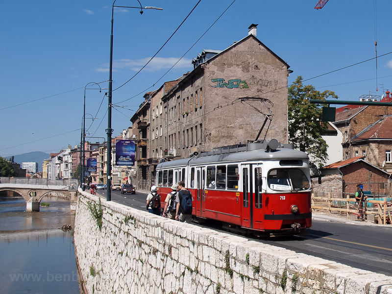 Sarajevo - type E1 tram bought from Vienna at the bank of the Miljacka river photo