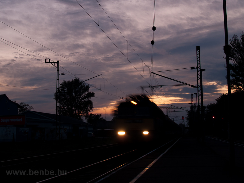 A V43 is passing through Balatonfenyves station by sunset photo