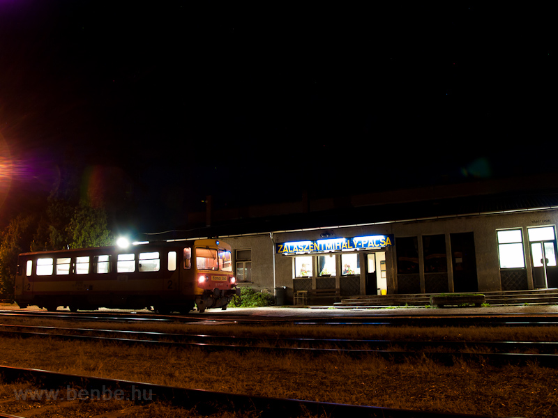 The MÁV-START Bzmot 390 is waiting for another train to pass by at Zalaszentmihály-Pacsa station photo