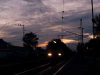A V43 is passing through Balatonfenyves station by sunset