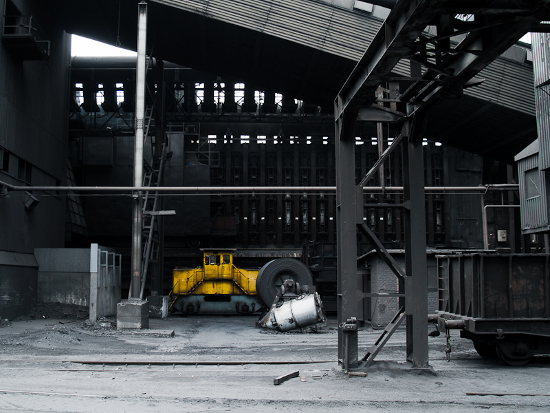 Battery rail tractor and an internal transport car at the coke plant photo