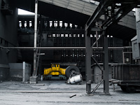 Battery rail tractor and an internal transport car at the coke plant
