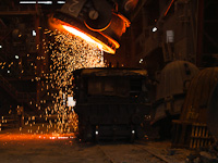 Emptying steel mill slag in a slag car at Dunaferr