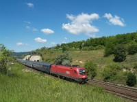 The �BB 1116 005-8 is hauling the very delayed EN Wiener Walzer near Sz�r, Hungary