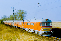 One of the prototype Piroskas, MDmot 3001 is passing by near Pusztaszabolcs hauling a train from B�tasz�k