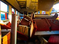 The interior of an Ax type 1st class MDmot trailer at S�toralja�jhely before being scrapped