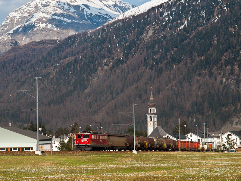 The RhB Ge 6/6 II  706 is seen hauling a freight train in Val Bever photo