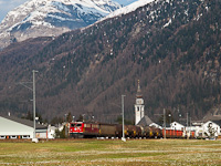 The RhB Ge 6/6<sup>II</sup> 706 is seen hauling a freight train in Val Bever