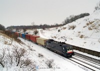 The MRCE-Dispolok ES64 U2 - 069 with a container train at Sz�r