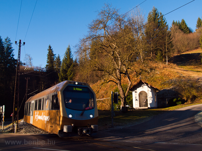 The Mariazellerbahn's Himmelstreppe railcar of road number ET1 seen between Frankenfels and Schwarzenbach where the Natters forks into the Pielach river photo