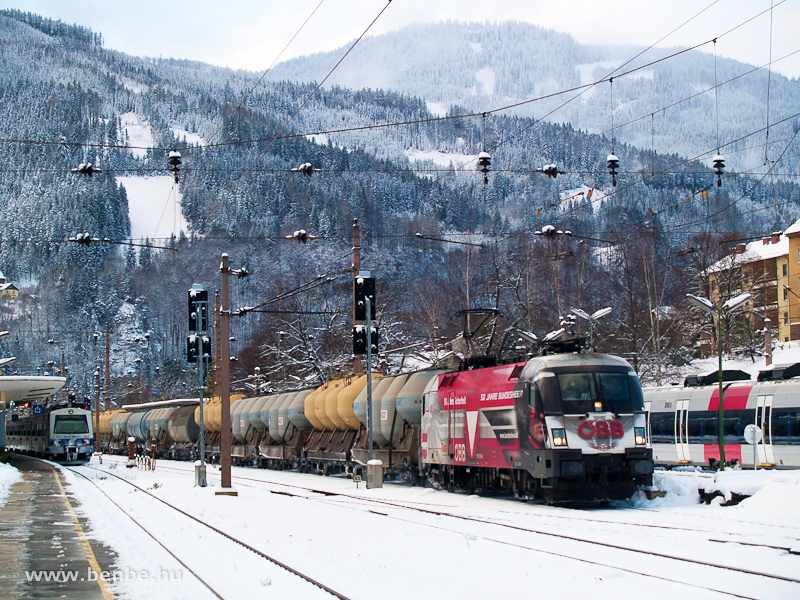 The ÖBB 1116 246-8  50 Jahre Bundesheer -Taurus with a silo wagon freight train at Mürzzuschlag station photo
