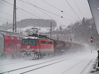 The ÖBB 1142 626-9 pushing a freight train up the Semmering Northern ramp at Payerbach-Reichenau station
