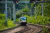 The Wiener Lokalbahnen AG's MRCE-Dispolok X 4 E - 605 Siemens Vectron is seen passing through the freight train through track of Payerbach-Reichenau station