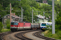 The ÖBB 1144 095 and the 1144 245 are seen hauling an InnoFreight goods train at Payerbach-Reichenau station lying at the feet of the Semmering pass