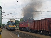 The M62 230 with an empty gravel train and the V43 1007 with an InterCity to Szeged at Kecskem�t