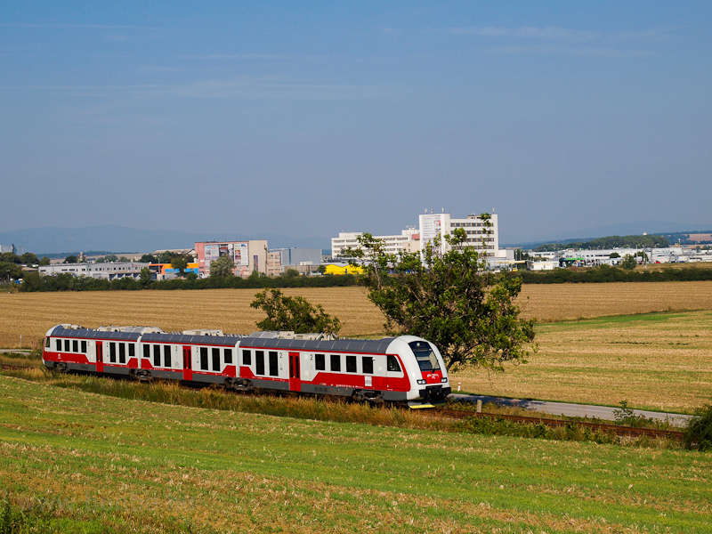 The ŽSSK 861 010-1 seen between Zlaté Moravce and Tešárske Mlyňány photo