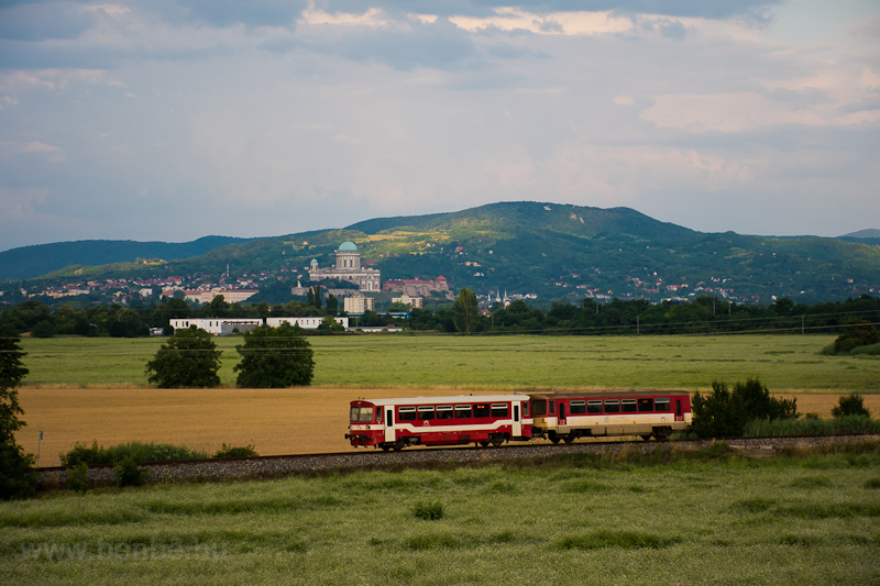 The ŽSSK 812 050-7 seen between Stúrovo and Kamenny Most nad Hronom with the Basilica of Esztergom in the background photo