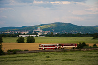 The ŽSSK 812 050-7 seen between Stúrovo and Kamenny Most nad Hronom with the Basilica of Esztergom in the background
