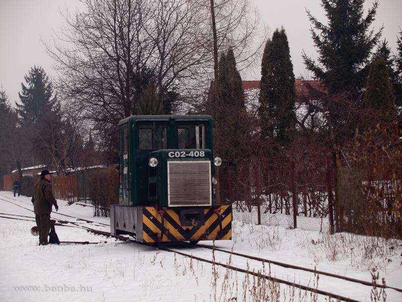 A LÁEV C02-408 pályaszámú C50-ese körbejár a Dorottya utcában fotó