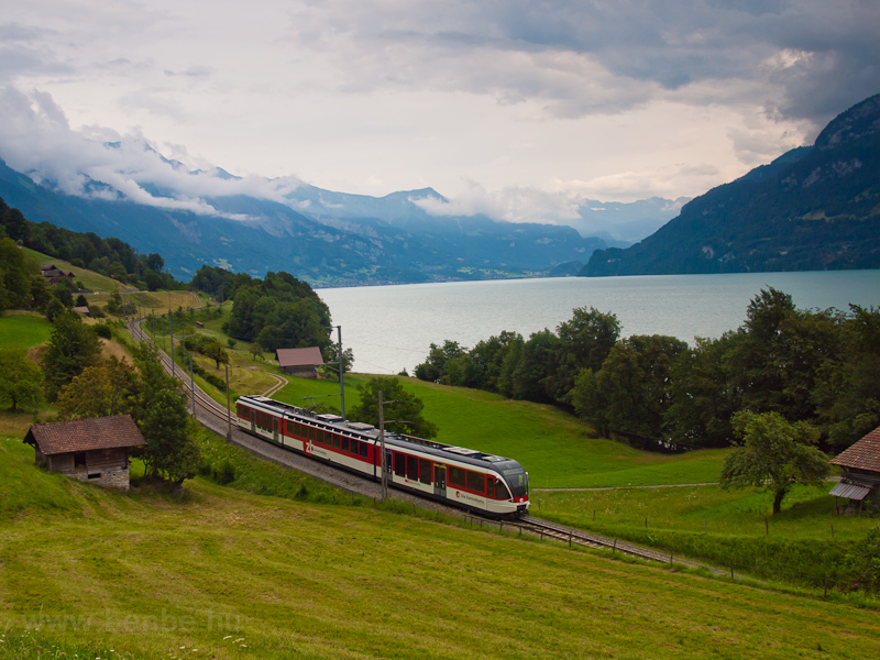 The Zentralbahn ABe 130 010-2 Spatz adhesion-only regional electric multiple unit seen between Oberried and Niederried on the bank of the Brienzersee photo