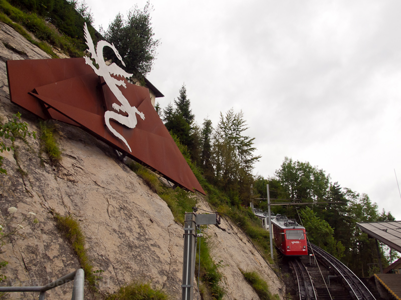 The logo of the Pilatus Railway and the starting station photo