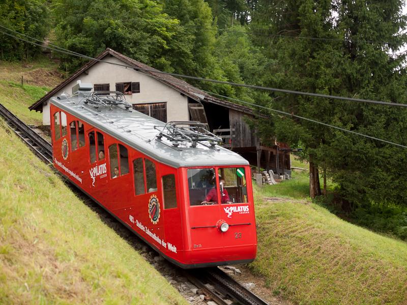 The Pilatusbahn (PB) Bhe 1/2 23 seen between Aemsigen and Alpnachstad photo
