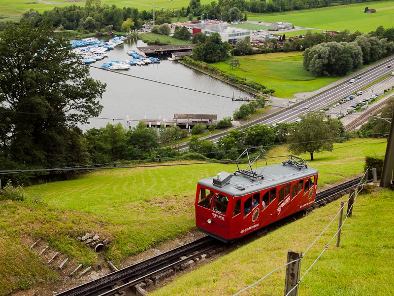 The Pilatusbahn (PB) Bhe 1/2 27 seen between Alpnachstad and Aemsigen photo