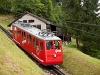 The Pilatusbahn (PB) Bhe 1/2 23 seen between Aemsigen and Alpnachstad