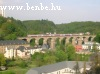 A DoSto passanger train on Pfaffenthal viaduct in Luxembourg