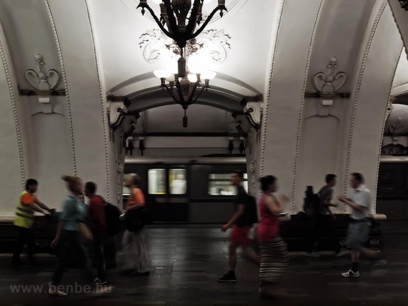 People hurrying around at Arbatskaya metro station (Arbatsko-pokrovskaya line, dark blue) photo