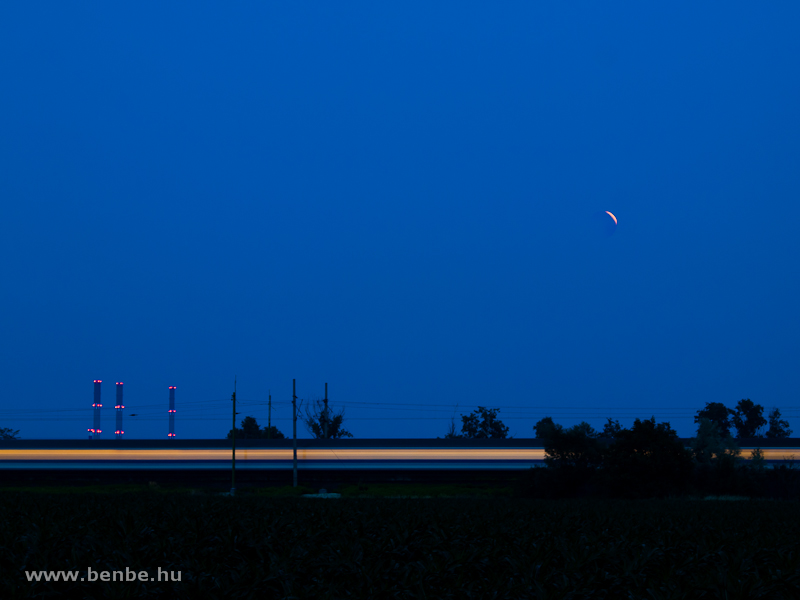 A fast train under the lunar eclipse photo
