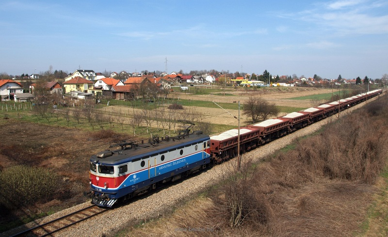 The HŽ 1141 381-2 is hauling a freight train near Kapronca (Koprivnica, Croatia) photo