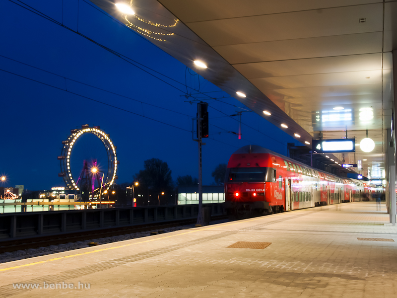 The ÖBB 86-33 031-4 double-decker driving trailer by the famous Ferris-wheel of the Prater theme park at Wien-Praterstern photo