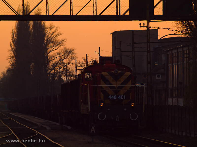 The MÁV-TR 448 401 (ex M44 401) at Kispest station by sunset photo