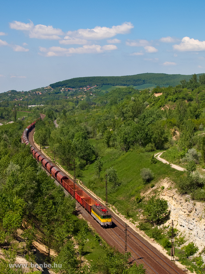 The GYSEV !3 328 is hauling a freight train uphill near Alsógalla photo