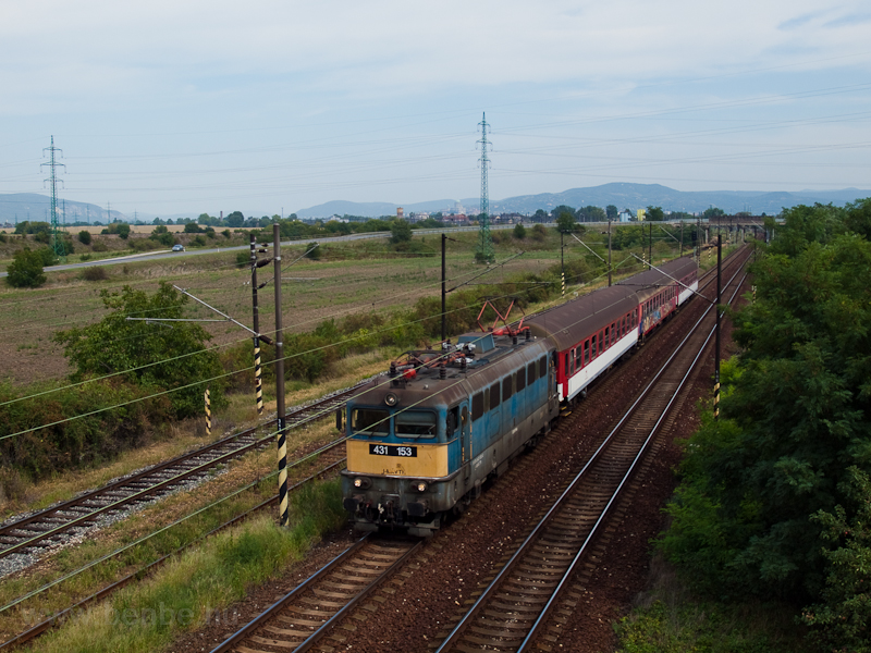 The MÁV-TR 431 153 is hauling a domestic Slovakian stopping train near Párkány-Nána photo