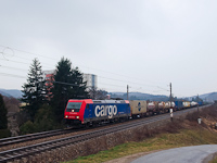 The SBB-Cargo 482 045-2 TRAXX is hauling a container freight train by Dürrwien